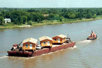 Houses moved on river barge